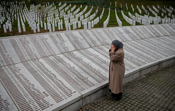 A woman praying on Thursday at a memorial in Potocari, Bosnia and Herzegovina, for those killed in the Srebrenica massacre. Credit Dado Ruvic/Reuters