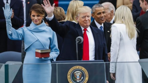epa05735469 Donald J. Trump waves after taking the oath of office as the 45th President of the United States in Washington, DC, USA, 20 January 2017. Trump won the 08 November 2016 election to become the next US President. EPA/SHAWN THEW